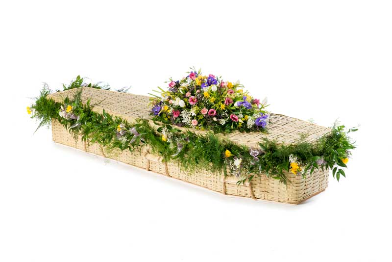 Bamboo eco coffin with floral garland
