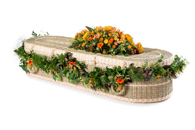 Eco pandanus coffin with orange flower garland