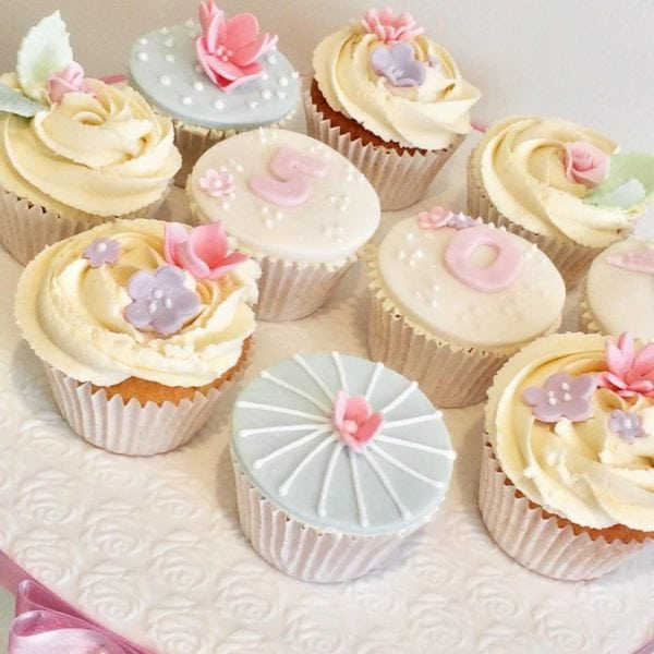 iced board with cupcakes