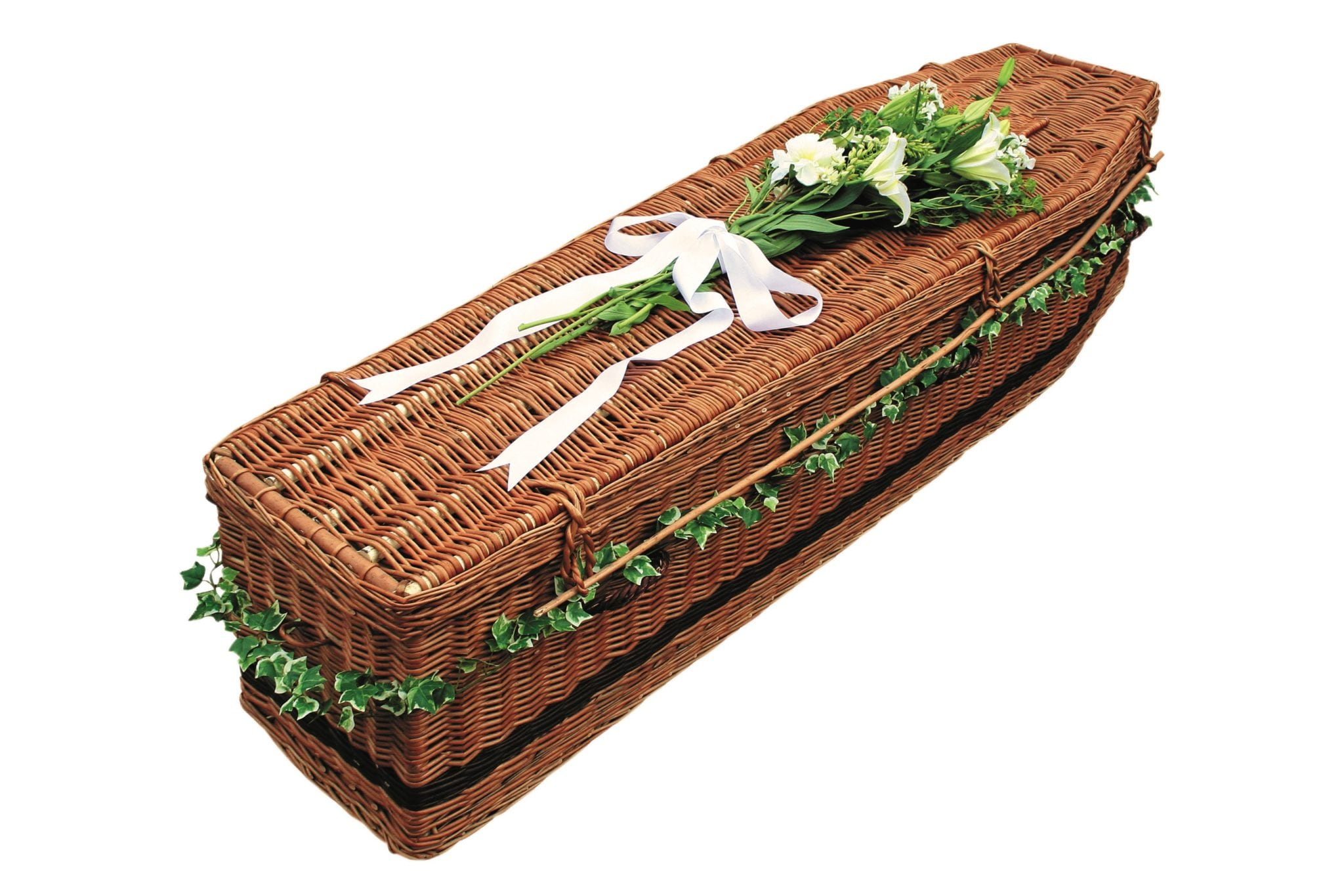 Dark wicker coffin with flowers on top