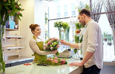 Man and woman in a florist