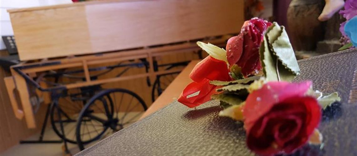 Single rose on coffin