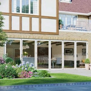 Bi fold doors out into a neat patio and garden