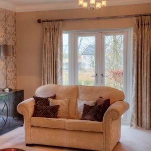 White french doors in a cosy living room