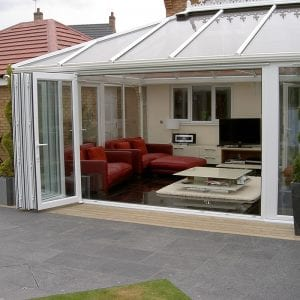 Large conservatory with open uPVC bi fold doors