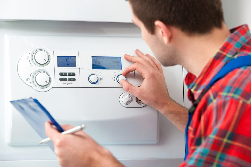 Technician-servicing-heating-boiler